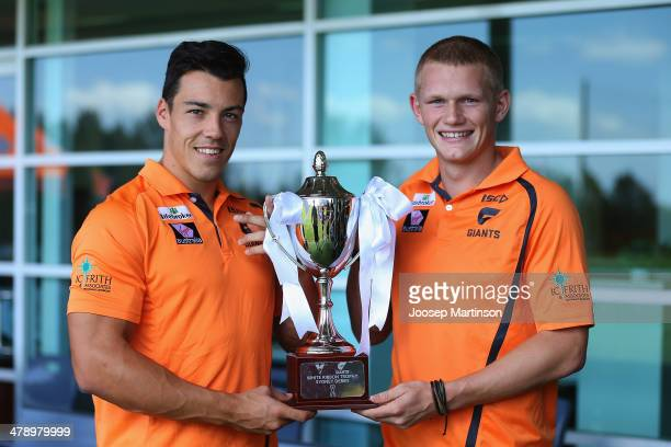 Daniel Shiel and Adam Treloar pose with the White Ribbon Trophy during a Greater Western Sydney Giants Media Session AFL media session at Tom Willis...