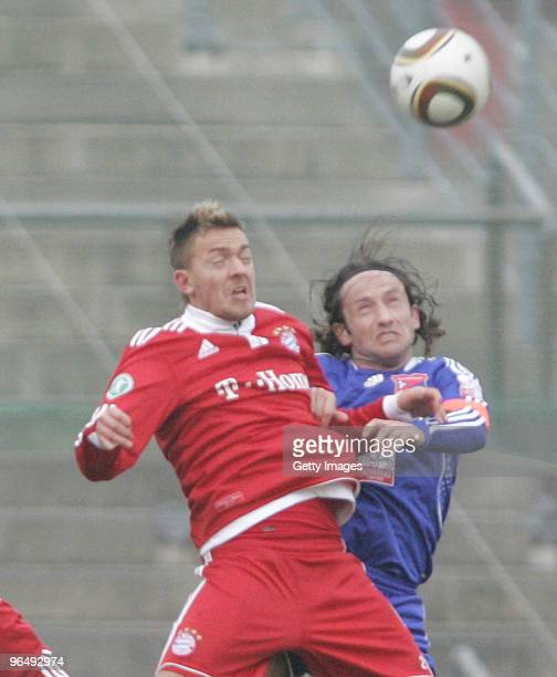 Daniel Sikorski of Bayern II and Roman Tyce of Unterhaching battle for the ball during the 3Liga match between SpVgg Unterhaching and Bayern Muenchen...