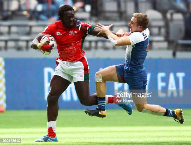 Daniel Sikuta of Kenya runs the ball against Aleksandr Afanasev of Russia during the Canada Sevens the Sixth round of the HSBC Sevens World Series at...