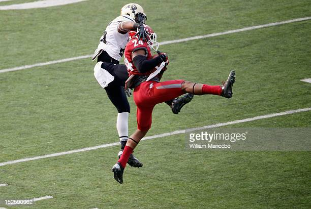 Daniel Simmons of the Washington State Cougars makes a third quarter interception during the game against the Colorado Buffaloes at Martin Stadium on...