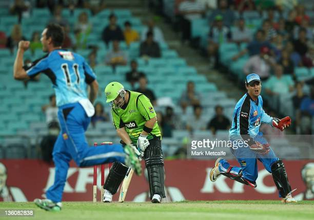 Daniel Smith of the Thunder is bowled by Aaron O'Brien of the Strikers during the T20 Big Bash League match between the Sydney Thunder and the...