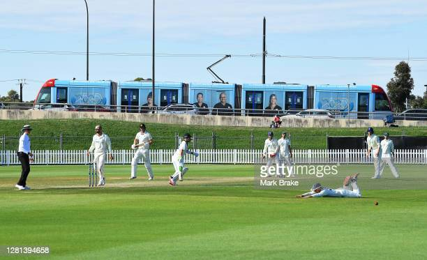 Daniel Solway of the Blues dives and misses a ball hit by Cameron Green of Western Australia as a tram passes during day three of the Sheffield...