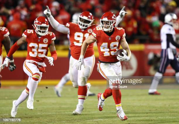 Daniel Sorensen of the Kansas City Chiefs celebrates with teammates after intercepting a pass in the fourth quarter against the New England Patriots...