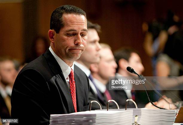 Daniel Sparks former partner and head of mortgages with Goldman Sachs Group Inc looks through exhibit documents during a hearing on Wall Street and...