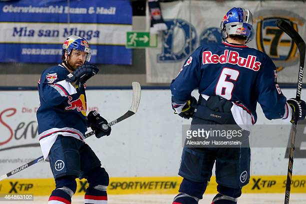 Daniel Sparre of Muenchen celebrates scoring the 2nd team goal with his team mate Daryl Boyle during the DEL Ice Hockey match between EHC Red Bull...