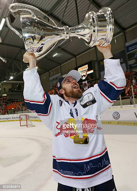 Daniel Sparre of Muenchen poses with the trophy after winning the DEL playoffs final game four between Grizzlys Wolfsburg and Red Bull Muenchen at...