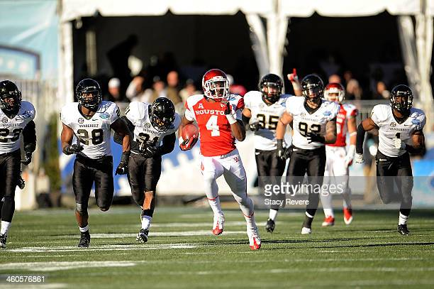 Daniel Spencer of the Houston Cougars runs for yards against the Vanderbilt Commodores during the BBVA Compass Bowl at Legion Field on January 4 2014...