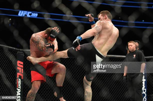Daniel Spitz kicks Mark Godbeer of England in their heavyweight bout during the UFC 209 event at T-Mobile Arena on March 4, 2017 in Las Vegas, Nevada.