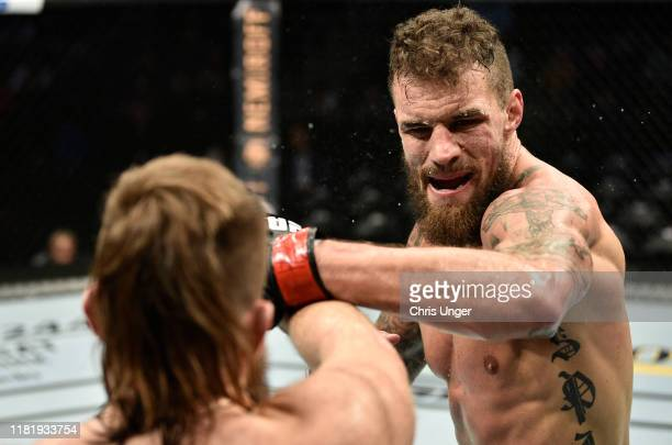 Daniel Spitz punches Tanner Boser in their heavyweight bout during the UFC Fight Night event at TD Garden on October 18, 2019 in Boston,...