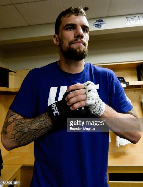 Daniel Spitz puts on his gloves backstage during the UFC Fight Night event inside the PPG Paints Arena on September 16, 2017 in Pittsburgh,...