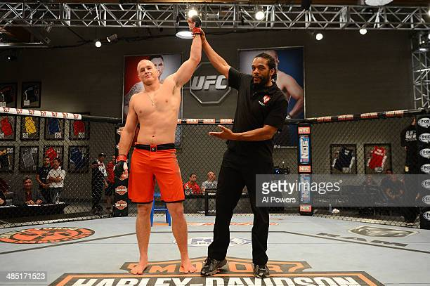 Daniel Spohn celebrates after knocking out Tyler King in their elimination fight during filming of season nineteen of The Ultimate Fighter on October...