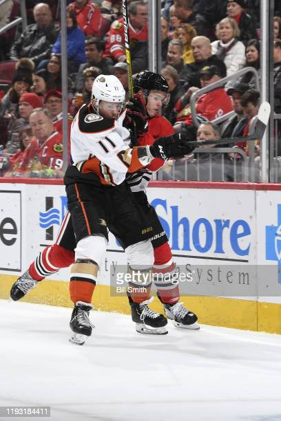 Daniel Sprong of the Anaheim Ducks and Olli Maatta of the Chicago Blackhawks get physical in the second period at the United Center on January 11,...