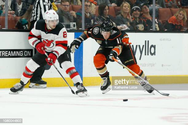 Daniel Sprong of the Anaheim Ducks and Will Butcher of the New Jersey Devils fight for control of the puck at Honda Center on December 09 2018 in...