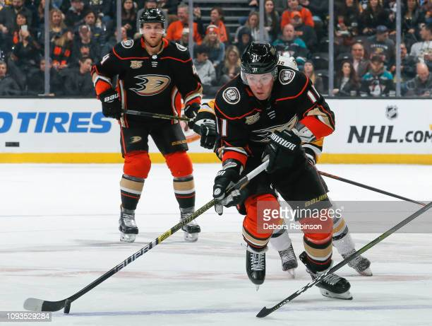 Daniel Sprong of the Anaheim Ducks skates with the puck with pressure from Marcus Pettersson of the Pittsburgh Penguins during the first period of...