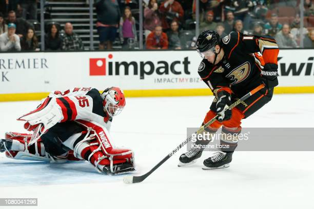 Daniel Sprong of the Anaheim Ducks takes a shot on goal as Cory Schneider of the New Jersey Devils blocks at Honda Center on December 09 2018 in...