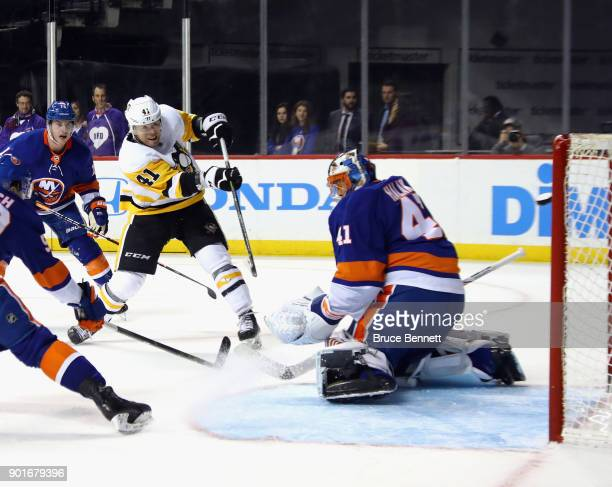 Daniel Sprong of the Pittsburgh Penguins scores his second goal of the game at 1328 of the third period against Jaroslav Halak of the New York...