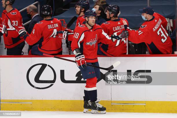 Daniel Sprong of the Washington Capitals celebrates his goal with teammates against the Boston Bruins during the first period at Capital One Arena on...