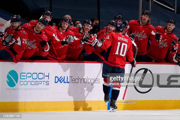 Daniel Sprong of the Washington Capitals celebrates with his teammates after scoring a goal against the New York Islanders in the first period at...