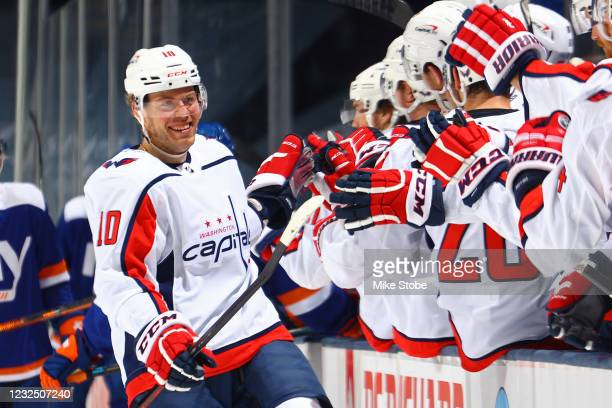 Daniel Sprong of the Washington Capitals is congratulated by his teammates after scoring a goal against the New York Islanders during the third...