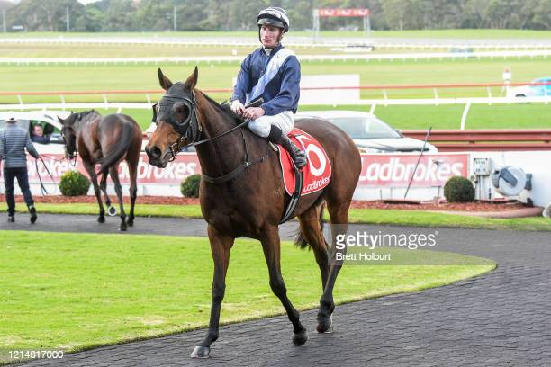 Daniel Stackhouse returns to the mounting yard on Kiss And Cry after winning the Ladbrokes Same Race Multi Handicap at Ladbrokes Park Lakeside...