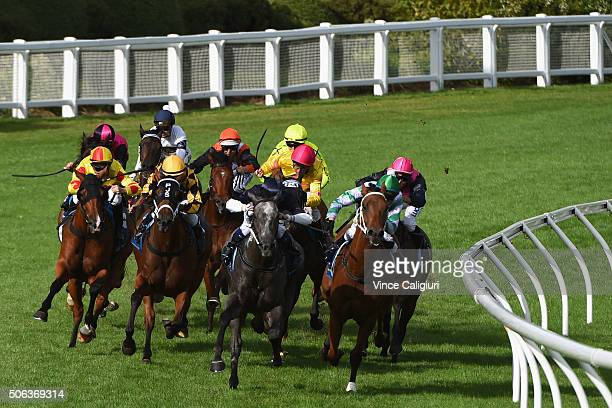 Daniel Stackhouse riding Tuff Host turns into straight before winning Race 9 during Melbourne Racing at Moonee Valley Racecourse on January 23 2016...