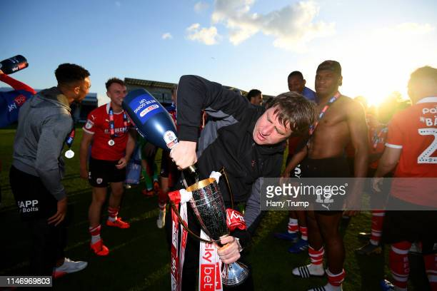 Daniel Stendel Manager of Barnsley celebrates with runnerup trophy as his team are promoted following the Sky Bet League One match between Bristol...