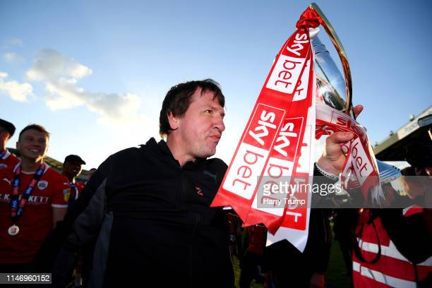 Daniel Stendel Manager of Barnsley celebrates with trophy as his team are promoted following their restul in the Sky Bet League One match between...