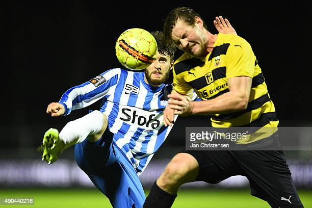 Daniel Stenderup of Esbjerg fB and Pal Alexander Kirkevold of Hobro IK compete for the ball during the Danish Alka Superliga match between Hobro IK...