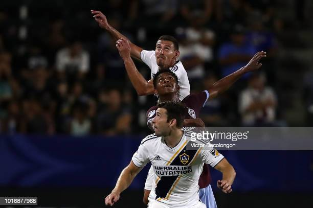 Daniel Steres and Dave Romney of Los Angeles Galaxy get in position to vie for the ball against Niki Jackson of Colorado Rapids during the second...