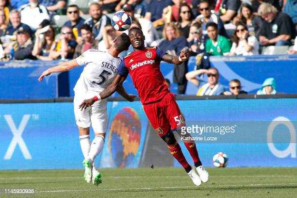 Daniel Steres of Los Angeles Galaxy and Sam Johnson of Real Salt Lake go up for a header during a game at Dignity Health Sports Park on April 28 2019...