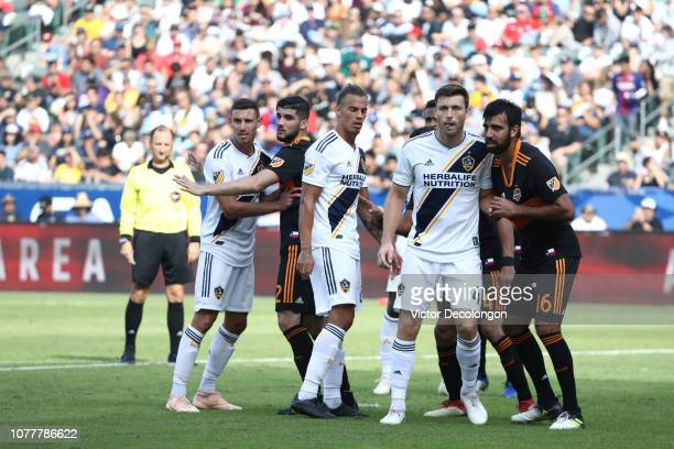 Daniel Steres Rolf Feltscher and Dave Romney of Los Angeles Galaxy line up against Alejandro Fuenmayor and Kevin Garcia of Houston Dynamo before a...