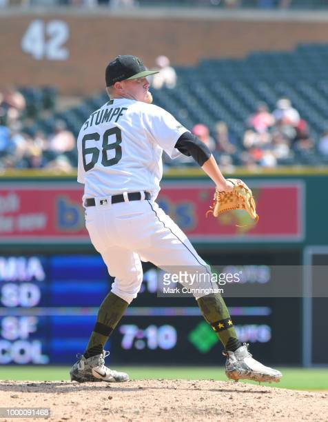 Daniel Stumpf of the Detroit Tigers pitches while wearing a special jersey shoes socks and hat to honor Memorial Day during the game against the Los...