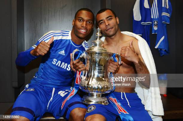 Daniel Sturridge and Ashley Cole of Chelsea celebrate with the trophy in the changing room after the FA Cup Final with Budweiser between Liverpool...