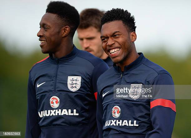 Daniel Sturridge and Daniel Welbeck share a joke during the England training session at London Colney on October 10, 2013 in St Albans, England.