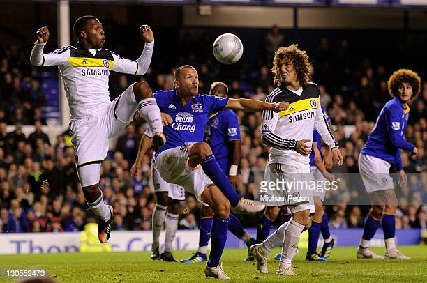 Daniel Sturridge and David Luiz of Chelsea compete with John Heitinga of Everton during the Carling Cup Fourth Round match between Everton and...
