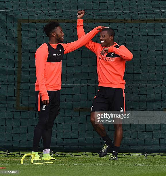 Daniel Sturridge and Georginio Wijnaldum of Liverpool during a training session at Melwood Training Ground on September 30 2016 in Liverpool England