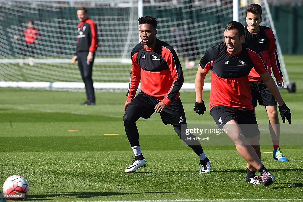 Daniel Sturridge and Jose Enrique of Liverpool during a training session at Melwood Training Ground on March 31, 2016 in Liverpool, England.