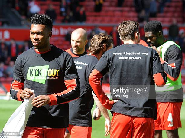Daniel Sturridge and Liverpool players wear the kick it out T Shirt during the warm up before the Barclays Premier League match between Liverpool and...