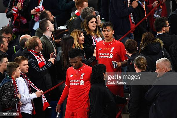Daniel Sturridge and Roberto Firmino of Liverpool walk after receiving the runnersup medals at the award ceremony after the UEFA Europa League Final...