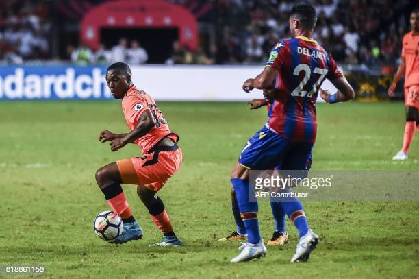 Daniel Sturridge controls the ball while Damien Delaney of Crystal Palace runs in during a 2017 Premier League Asia Trophy fixture at Hong Kong...