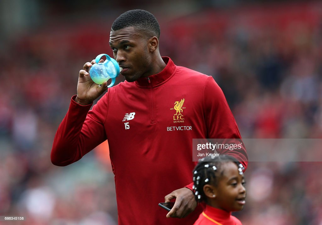 Daniel Sturridge drinks from a baby child bottle during the Premier League match between Liverpool and Middlesbrough at Anfield on May 21, 2017 in Liverpool, England.