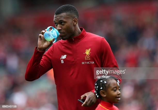Daniel Sturridge drinks from a baby child bottle during the Premier League match between Liverpool and Middlesbrough at Anfield on May 21 2017 in...