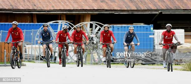 Daniel Sturridge Georginio Wijnaldum Emre Can Mohamed Salah and Sadio Mane of Liverpool on a bike riding to a training session at RottachEgern on...