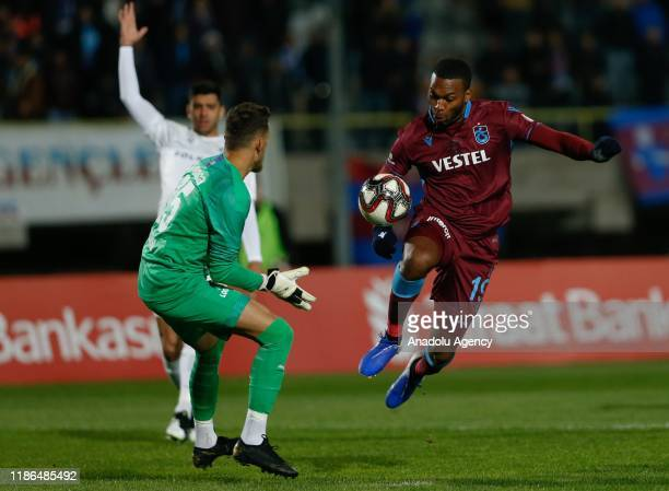 Daniel Sturridge in action against Cihan Topaloglu of Altay during Ziraat Turkish Cup 5th round soccer match between Altay and Trabzonspor at Izmr...
