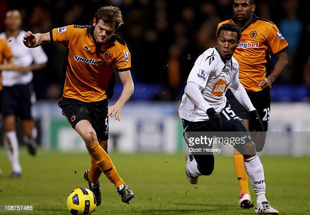 Daniel Sturridge of Bolton in action with Richard Stearman of Wolves during the Barclays Premier League match between Bolton Wanderers and...