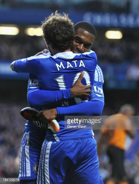 Daniel Sturridge of Chelsea celebrates scoring his side's second goal with team mate Juan Mata during the Barclays Premier League match between...