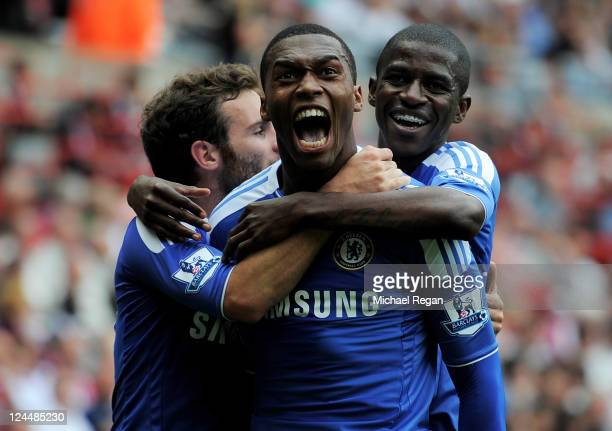 Daniel Sturridge of Chelsea celebrates with team mates Ramires and Juan Mata after scoring his team's second goal during the Barclays Premier League...