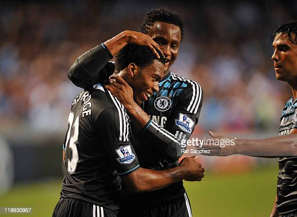 Daniel Sturridge of Chelsea is congratulated by John Obi Mikel after scoring during the Asia Trophy preseason friendly match between Kitchee and...