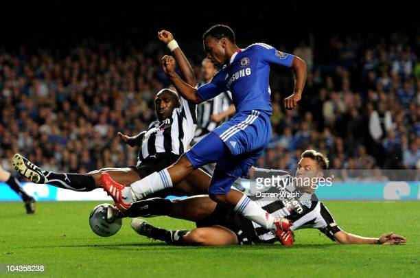 Daniel Sturridge of Chelsea is tackled by Sol Campbell and Alan Smith of Newcastle during the Carling Cup third round match between Chelsea and...