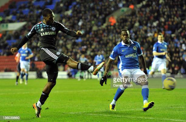 Daniel Sturridge of Chelsea scores the opening goal during the Barclays Premier League match between Wigan Athletic and Chelsea at the DW Stadium on...
